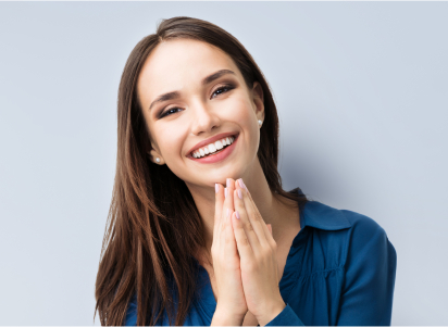 woman smiling with hands in prayer position