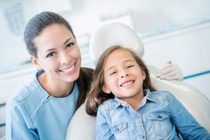 Pediatric dentist in Buffalo Grove teaches brushing and flossing.