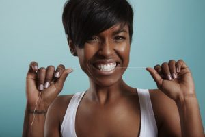 Woman with great flossing habits thanks to Buffalo Grove dentist